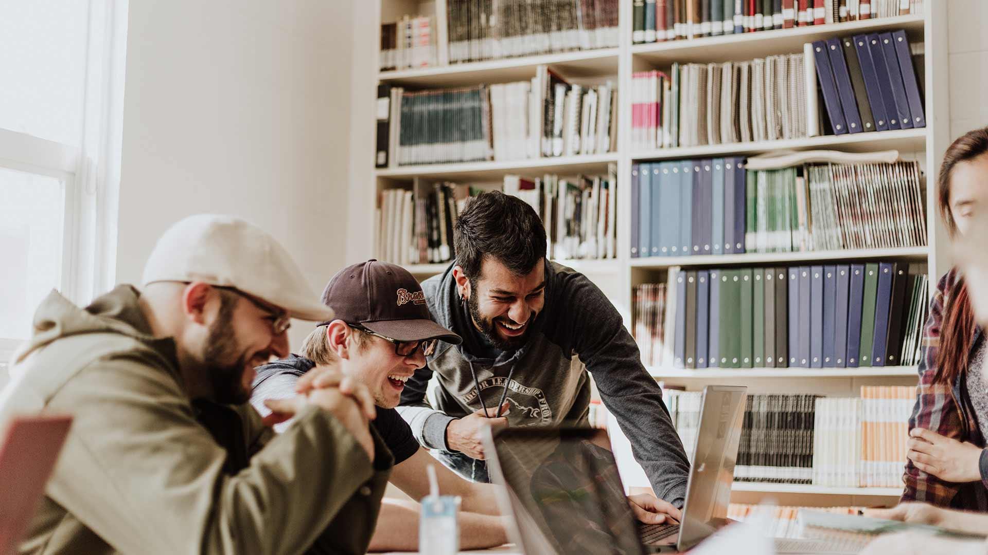 Men at Computer Laughing